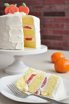 Chinese Bakery Style Orange and Strawberry Cream Cake. A light and fluffy orange sponge cake filled with sweet strawberries and airy whipped cream | www.thepudgyrabbit.com