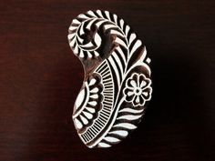 Check out this item in my Etsy shop https://www.etsy.com/listing/114211553/indian-wood-stamp-textile-stamp