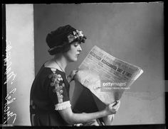 Mabel Normand silent film actress, sitting reading copy of Chicago Daily News, Chicago, Illinois, 1921. From the Chicago Daily News collection.