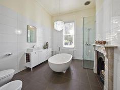 bathroom ideas with polished concrete, tiles, corner bath, freestanding bath, recessed bath and spa bath