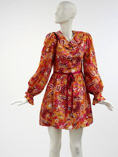 Printed polyester mini dress with wine-coloured velvet ribbon belt, by Paul Babb and Pamela Proctor for Twiggy Dresses, English, 1967-69. Model Twiggy launched her fashion label 'Twiggy Dresses' on February 16, 1967. She did all the modelling and publicity, and worked with the designers to ensure they designed clothes she would happily wear herself. This personal input and strong branding enabled the label to run successfully for three years.