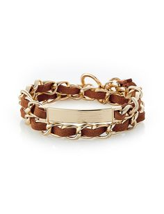 Sparkling faux suede wrapped around a dazzling chain is a lovely addition to your polished look.