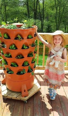 The composting 50 plant accessible vertical Garden Tower for organic patio vegetable gardening by Garden Tower Project. #patiovegetablegardening