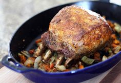 This pork rib roast is roasted to perfection on a bed of sauteed aromatic vegetables. The spice rub brings out the flavor of the meat.