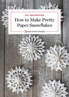 Nine Ways To Take Paper Snowflakes To The Next Level Making Paper Snowflakes, Diy Christmas Snowflakes, Paper Snowflake Patterns, Snowflake Craft, Christmas Paper Crafts, Holiday Crafts, Christmas Crafts, Paper Snowflake Template, Diy Snowflake Decorations
