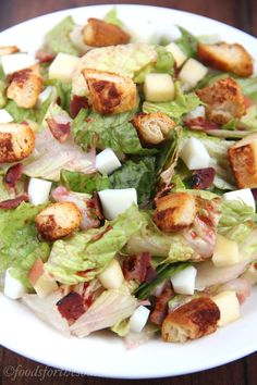 Cinnamon Roll Breakfast Salad -- a light, healthy & protein-packed meal. The cinnamon roll croutons are a genius idea!