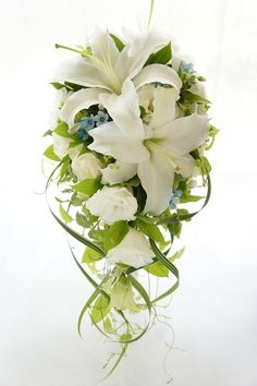 Picking the Perfect Flower Wedding Bouquet Lilly Bouquet Wedding, Cascading Wedding Bouquets, Bridal Bouquet Fall, Bride Bouquets, Bridal Flowers, Floral Bouquets, Floral Wedding, White Lily Bouquet, Trailing Bouquet