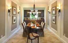 Cabinets flank a window in the dining room of the St. Tropez plan. One of seven new homes built by Minto Communities at PortoSol. Royal Palm Beach, FL.