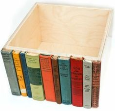 Old book spines glued to a box. Great idea for a hidden bookshelf storage.  Love this idea!