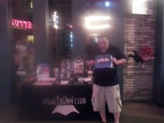 """Michael watching """"The Dark Knight"""" and earning Facebook Credits through Plink.com at Regal 18 Cinema in Delray Beach, FL"""