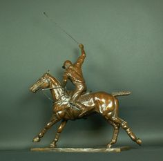 """POLO XII,  Bronze, """"Off Side Forehand""""  Bronze  Edition 1/9  31 x 25 inches  Signed   $12,500    NB Two views of this sculpture depicting a darker patina and another, lighter and more golden in colour are available by email request:  info@chisholmgallery.com"""