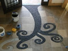 Entryway Tile work - I like this :) not so much with the square tiles, but I love the idea