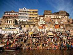 Bathe in the Ganges River During the Purna Kumbh Mela