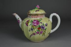 Teapot and cover; porcelain; painted in colours with gilding; roses etc. on yellow ground, which may be later addition; flower knop; marked.