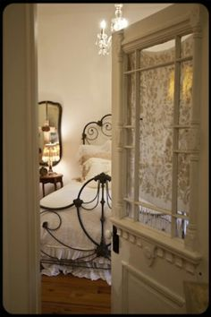 i like this - repurposing an antique exterior door as a bedroom entry.