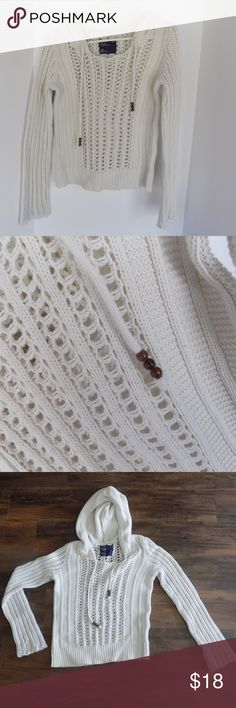 Gently used American Eagle Crochet Sweater Super cute beige colored crochet sweater.  Gently used and in excellent condition.  I consider it a year round sweater, casually in the summer you can wear it with a tank top and shorts, and in the winter, you can layer it for warmth. Sweaters Crew & Scoop Necks