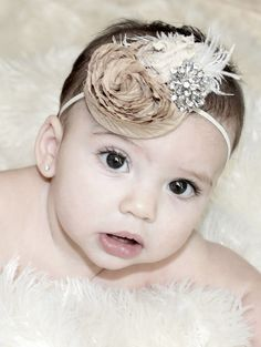 @Sarah Miller, would be so cute for my niece Brooklyn!! Vintage inspired rosette flower headband with feather.