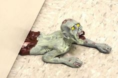 Zombie Door Stop - Take My Paycheck | The coolest gadgets, electronics, geeky stuff, and more! Shut up and take my money!
