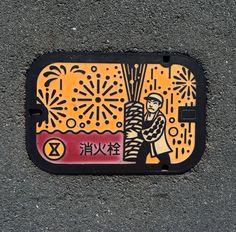Arm hold fireworks fire hydrant manhole. Place: Toyohashi city, Aichi, Japan.