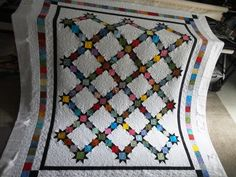 Cheryl's Trellis Stars, quilted by ONE LOOSE THREAD  Great pattern--I love modernized classics--and beautiful execution.