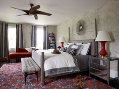 This luxe bohemian master bedroom features Alexander McQueen's Monarch Fire carpeting as the standout feature.