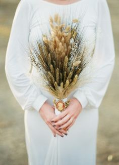 Winter Bridal Bouquet: blackbeard wheat, cattails, gypsophilia and pampas grass || photo courtesy of Clayton Austin