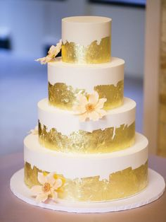 add a little bit of flare to a simple wedding cake with the addition of gold foil to each tier