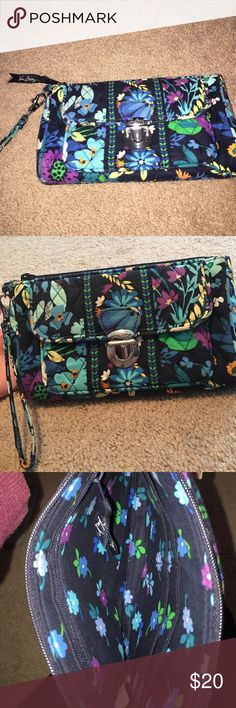 Vera Bradley Ultimate Wristlet Really good condition Vera Bradley Ultimate Wristlet. Navy blue with floral pattern. Front pocket holds IPhone. Inside has 4 card slots and extra pocket. Make me an offer! Vera Bradley Bags Clutches & Wristlets