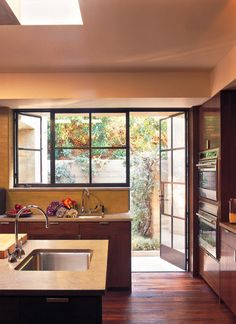 kitchen skylight plus I love the backdoor with the glass rimmed in steel