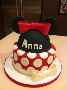 Double-sided cake:  One side Minnie Mouse and the other Mickey Mouse
