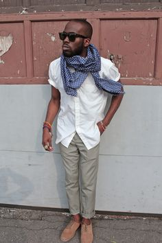 This guy shows how easy it is to style: simply throw a scarf on with your usual chino and shirt pairing. Done!