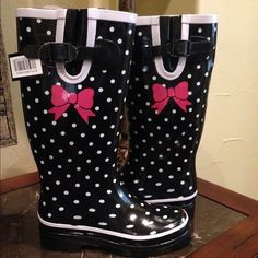 Black polka dotted rubber rain boots Black Polka Dotted Rain Boots. Hot pink decal. One of a kind. Perfect Christmas gift! These are ready to ship! More sizes now available.  Please know that some sizes are just black & white polka dot without the white trim.  trades ✅ posh rules only Boutique Shoes Winter & Rain Boots