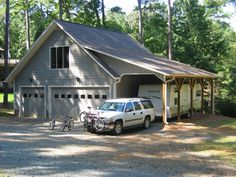 The PERFECT garage. Vertical board and batten siding with an overhang for a camper!