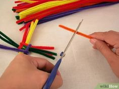 How to Make a St Brigid's Cross with Pipe Cleaners. This article will be telling you how to make a St Brigid's cross out of pipe cleaners. St Brigid is one of Ireland's patron Saints and she made a cross out of rushes to protect her from. Pipe Cleaner Crafts, Pipe Cleaners, St Brigid Cross, Brigid's Cross, Crafts For 3 Year Olds, Pagan Witchcraft, Spring Art, Patron Saints, Arts And Crafts