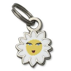 """Daisy Flower Charm  - Add this adorable mini charm to the Heart Link Charm bracelet. Jump ring on top. Silvertone iron with epoxy. 3/8"""". Imported. - www.gscocshop.org - $6.00"""