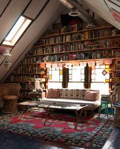 Searching for bookshelf decor inspiration? We love this floor-to-ceiling bookshelf wall in an attic.