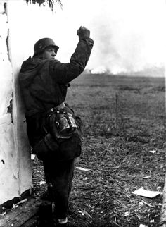 bag-of-dirt: A German Schutzstaffel officer of the 2nd SS Panzer Division Das Reich beckons to his men to advance during the Second Battle of Kiev near the outskirts of Zhytomyr. Near Zhytomyr, Zhytomyr Oblast, Ukraine, Soviet Union. December 1943.