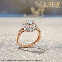 Flower shaped diamond ring with  round and princess cut diamonds.