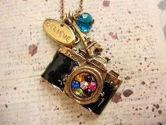 Vintage Style Camera Necklace with believe charm and Eiffel Charm. $9.99, via Etsy.
