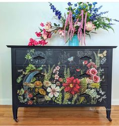 This was painted in Annie Sloan Oxford Navy paint.  The transfer is midnight garden by IOD and sealed with AS clear wax. It is such a beautiful transfer and very colorful.  This piece sold but please contact me for custom work. I ship furniture all throughout the US.  Questions? Send me an email through the website. I have lots of how-to vidoes on my YouTube channel on how to apply transfers and how to use wax. Decoupage Furniture, Funky Furniture, Custom Furniture, Vintage Furniture, Painted Furniture, Dark Blue Flowers, Navy Paint, Midnight Garden, Painting Cabinets