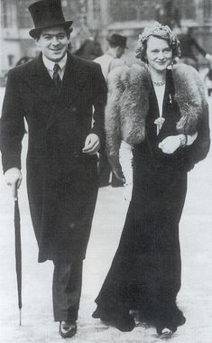 Photo of Maureen, Marchioness of Dufferin and Ava, in 1938, wearing her clover-leaf tiara to the State Opening of Parliament.