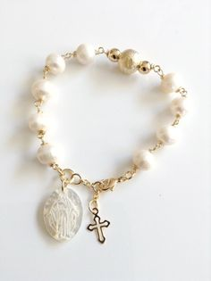 Really attractive, and I don't usually go in for religious jewelry. Nice! Virgin Mary Pendant Bracelet  This feminine and elegant bracelet is perfect for work or everyday wearing, made with 8 mm natural fresh water white