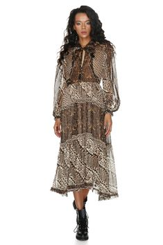 Mid-length and a frontal V-neck bow tie add a boho-chic vibe to this Vero Milano animal print ruffled dress with full sleeves. Ruffle Dress, Ruffles, Full Sleeves, Mid Length, Dresses Online, Designer Dresses, Boho Chic, Spring Summer, Bow