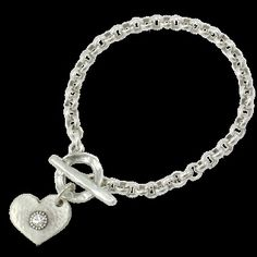 Silver plated rolo chain t-bar bracelet with a Swarovski crystal embedded in the mottled heart charm.