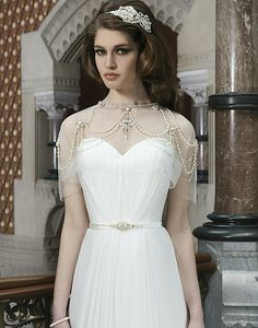 Great Gatsby inspired wedding dress.  #bride #wedding #caplet #vintage #gatsby #1920 #beading #roaring20s