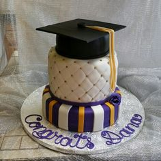 3 tier cake covered and decorated with fondant.