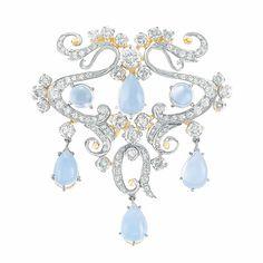 Diamond and Moonstone Pendant-Brooch  Platinum, gold, 17 diamonds ap. 2.00 cts., ap. 9.7 dwt.  Edwardian style.