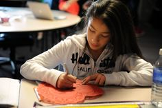 Fifth grader Karissa Martinez, 11, writes a goal during Healthy Heart Week at Ridgeview Elementary School in Falcon School District 49. Martinez committed to exercising one hour every day until the end of the school year. Fifth grade teacher Kyla Greenfield, a coordinated school health co-leader, taught her students how to write goals that are specific, measurable, attainable, realistic and timely, known as SMART goals. The school is spending the week completing healthy living activities.