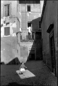 photo by Henri Cartier-Bresson, in Trastevere, Rome, Italy. - photo by Henri Cartier-Bresson, Henri Cartier Bresson, Candid Photography, Vintage Photography, Street Photography, Landscape Photography, Portrait Photography, Nature Photography, Travel Photography, Fashion Photography