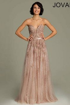 Floor length café gown features a strapless plunging sweetheart neckline, floral appliqués, a banded waistline and a hidden zipper in the back.